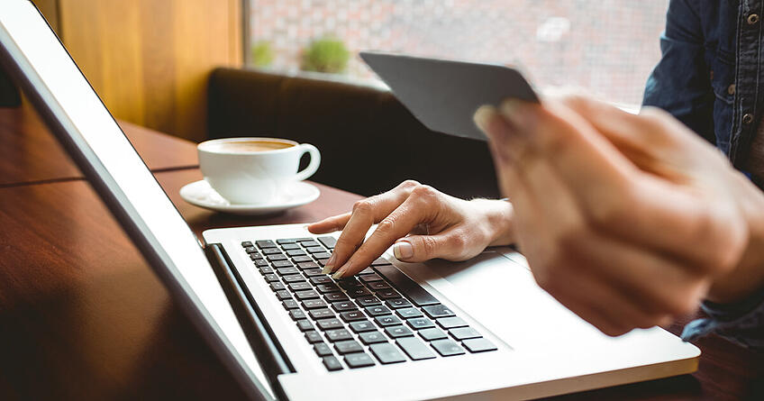 Person using a laptop to pay for a business website