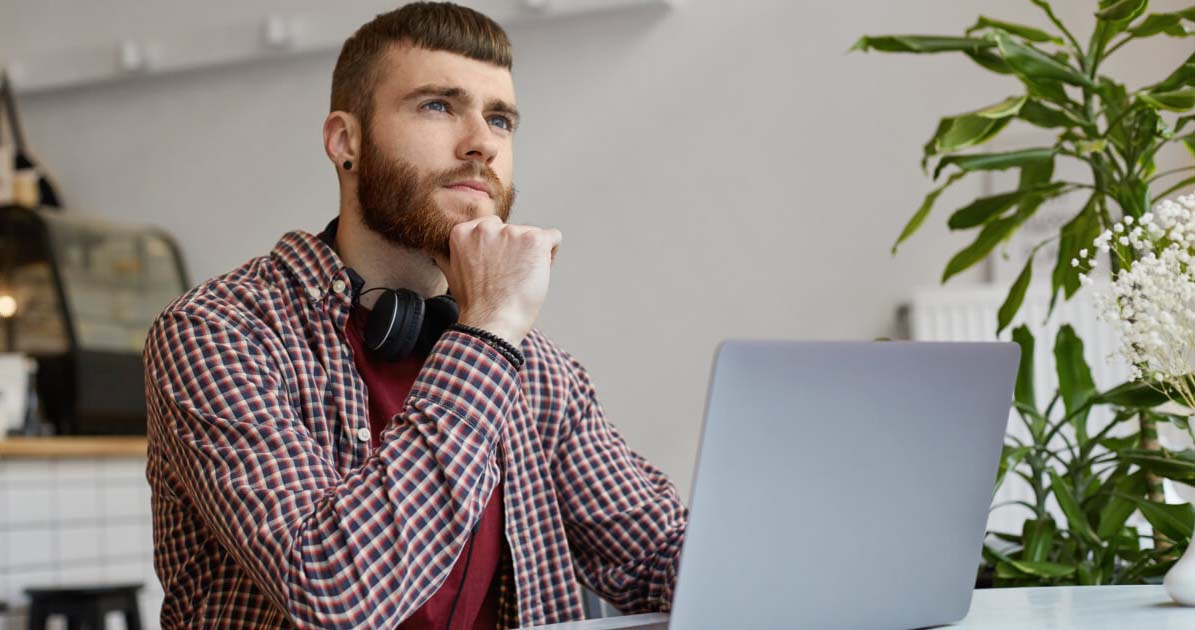 Young Man thinking about web design